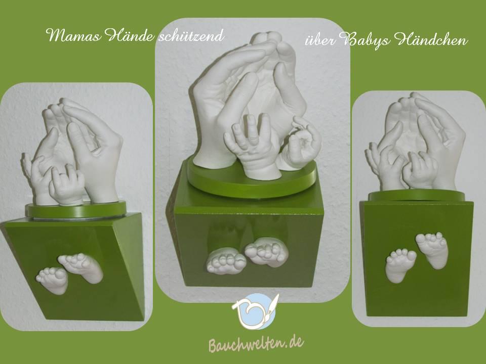 Mamahände, Babyhände und Füßchen auf Wandsockel in Grün